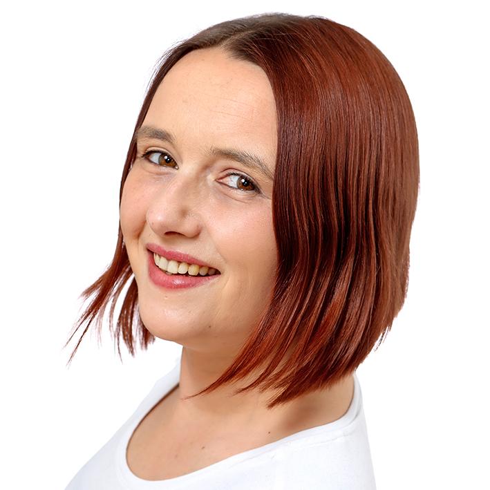 Bewerbungsbild einer jungen Frau mit Pagenschnitt