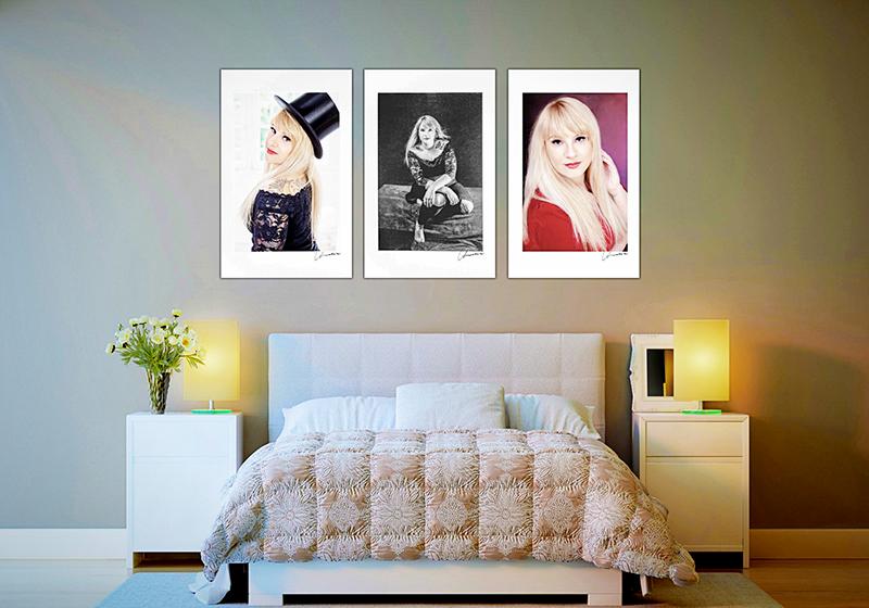 drei Bilder einer Serie an einer Wand über einem Bett